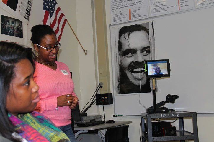 Alexandria Griffin, an HEHS graduate and a  police officer, and Evan F. Moore, an HEHS graduate and a journalist, answer English 108 students' questions. Griffin visited the class while Moore answered questions via Skype.