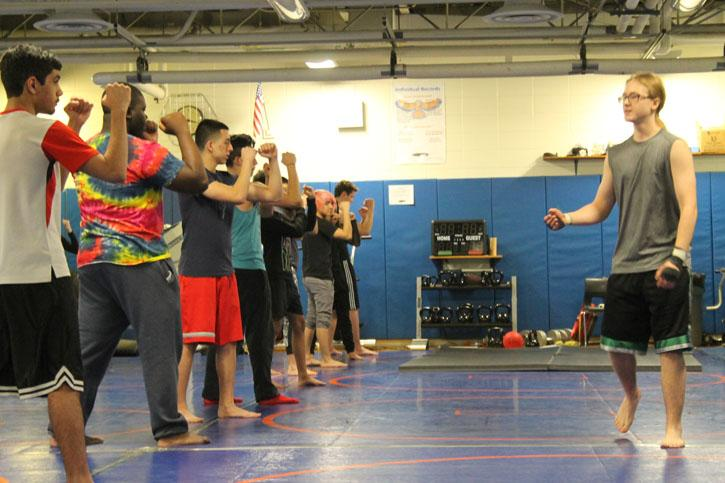 Christian Kanaga leads an afternoon practice for the Martial Arts Club.