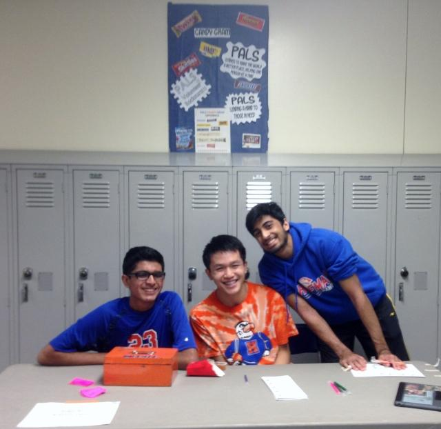Mihir Patel, Cody Mui, and Omar Quadri work together to sell Candy Grams during Parent Open House.