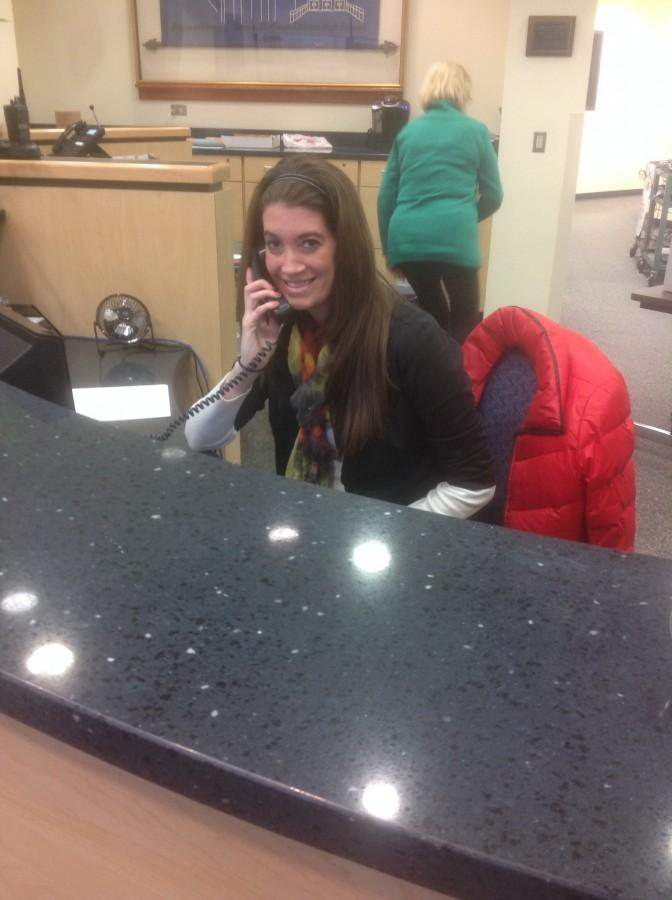 Ashley Faklaris juggles many tasks in the attendance office, including a multitude of phone calls.