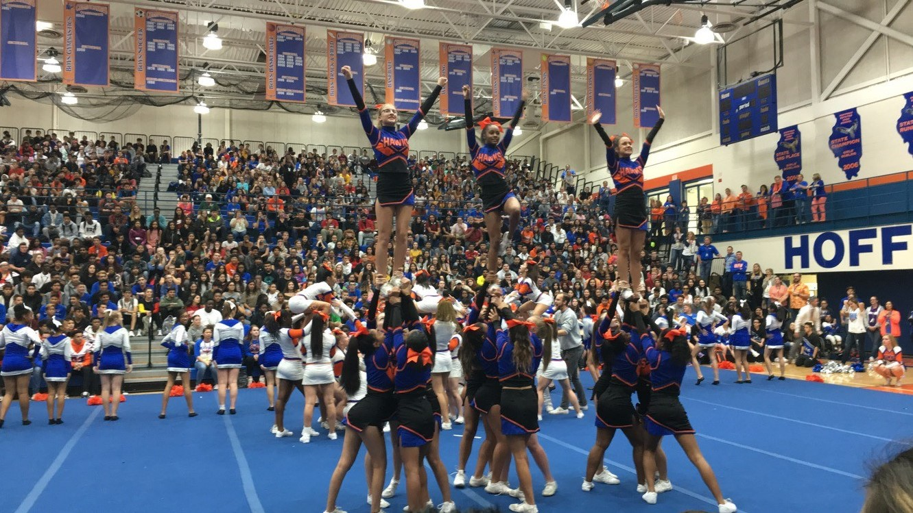 HEHS cheerleaders perform for students and staff at the Homecoming Kick-Off Assembly.